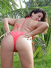 Flashing her pussy and her big tits outdoors