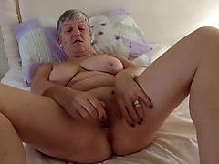 Real granny with big tits on hungry pussy