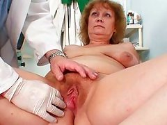 mature lady spreading her legs for her pussy examination