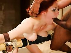 redhead bound to the bed's frame and penetrated