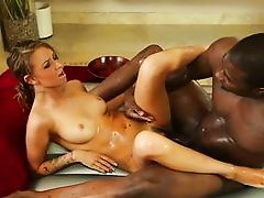 oiled white chick slides on a black dude